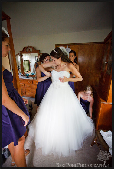 Jenny's bridesmaid's help her into her wedding dress Plessis NY