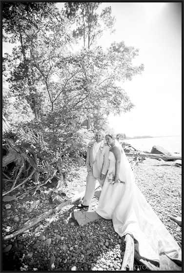 Danielle and David's rocky beach wedding pictures at Mexico Point State Park NY