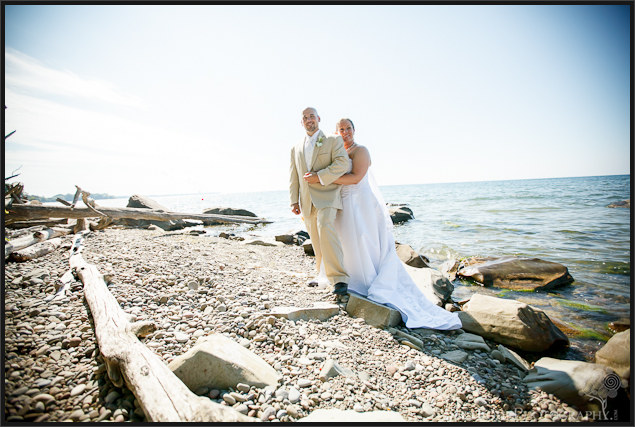 Danielle and David's rustic beach wedding pictures with drift wood at Mexico Point State Park NY