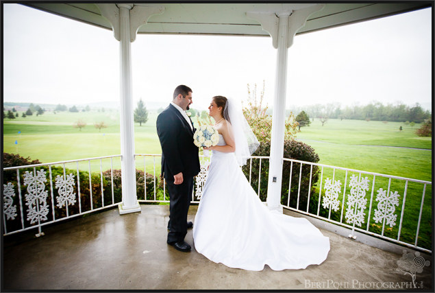 Ashley & Michael kiss on a misty golf course for wedding pics in upstate ny wedding photographers