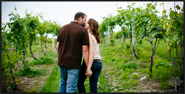 Ariel & Jeff walk along the vines at Tug Hill Winery Engagement Photographers