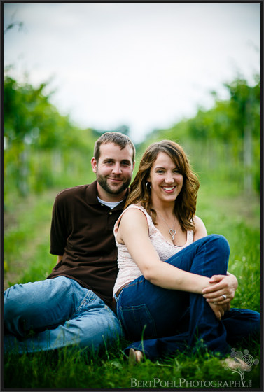 Ariel & Jeff relax along the vines at Tug Hill Vineyards Engagement Session Photographers