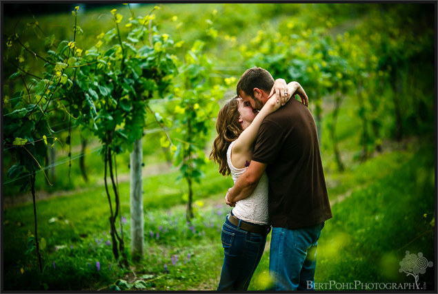 Ariel & Jeff kiss among the vines at Tug Hill Winery Engagement Photographers