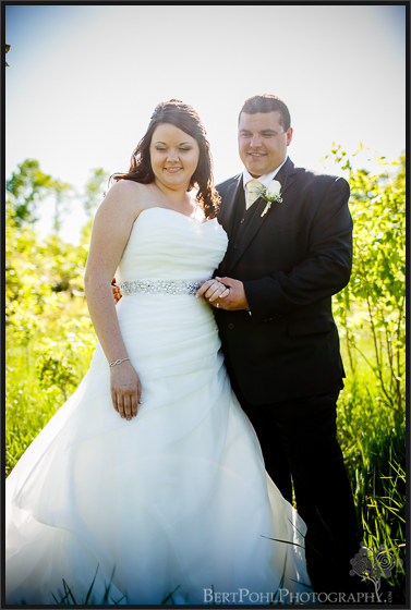 Jenny & Judd's summer outdoor wedding pictures in a grassy field near ogdensburg ny wedding photographer