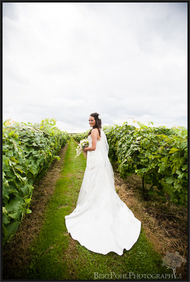Jen in vineyards at her wedding at Thousand Island Winery Wedding Photographers