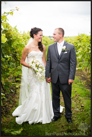 Jen & Randy walking along the vineyards at their wedding at Thousand Island Winery Wedding Photographers
