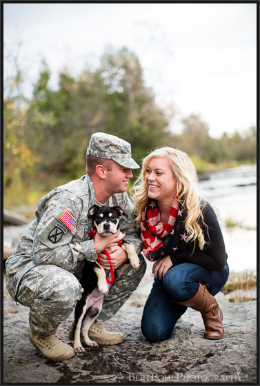 Brittany & Mark snuggle with their puppy for their engagement photos at sackets harbor ny engagement photographers