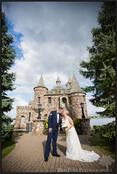 Heather & Joshua kiss by the generator house at Boldt Castle Wedding Photographer