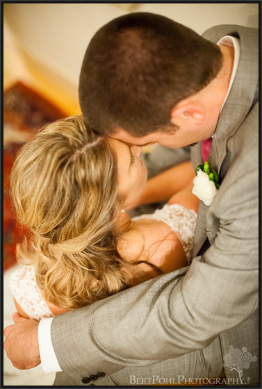 Erica & Ryan's kiss in the hall for their autumn wedding Upstate New York Wedding Photographers
