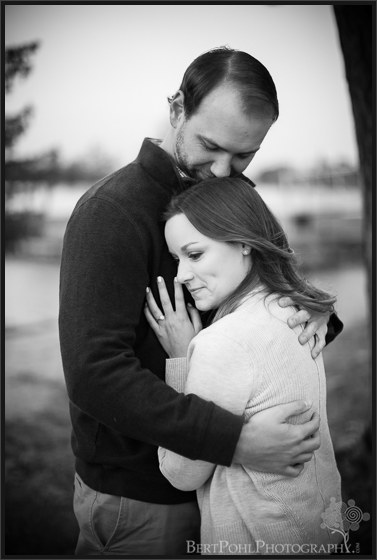 Chelsea & Kevin snuggle near the lake for an Alexandria Bay Engagement Photographers