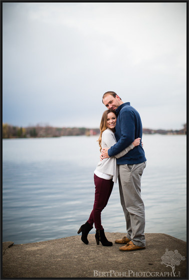 Chelsea & Kevin suggle near the lake for photos near Thousand Islands NY Engagement Photographers