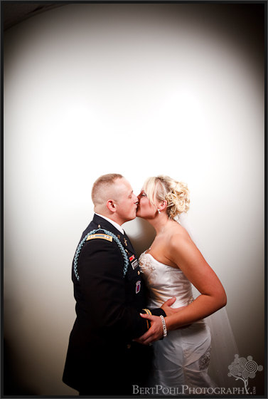 Jessica & William kissing wedding photos, Fort Drum NY