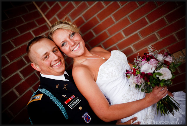 Jessica & Bill married snuggling Fort Drum NY